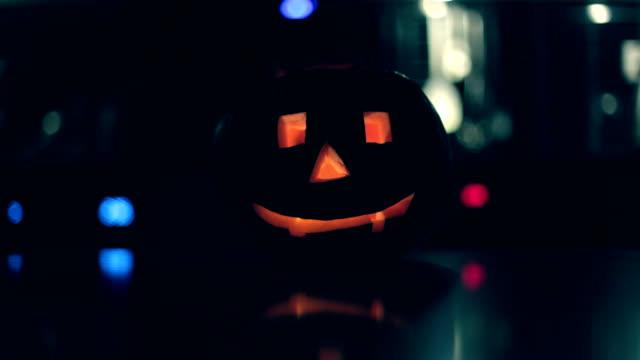 Halloween, pumpkin lamp on table
