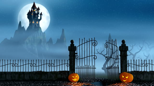 Halloween pumpkins next to a gate of a spooky castle