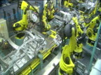 Halted robotic arms of car factory production line