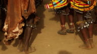 Hamar tribe during the Bull Jumping ceremony The young women are dancing with leg bells and traditional clothings
