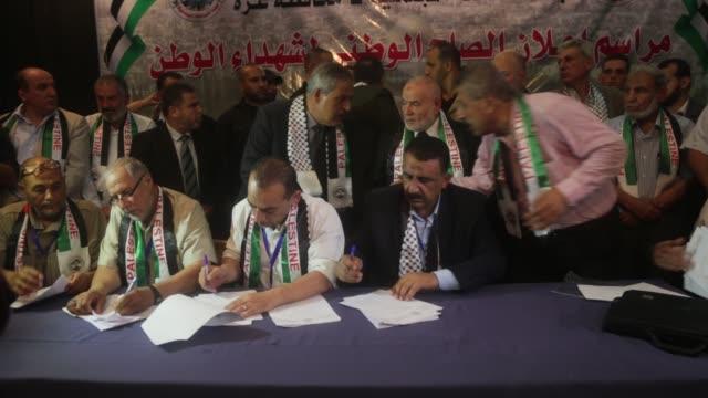 Hamas' MP and head of the parliament in Gaza City Ahmad Bahar and Palestinian MP Ashraf Jomaa MP Majed Abu Shamala attend a ceremony at which 14...