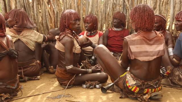 Hamer tribe - Hamer women preparing for the whipping ceremony