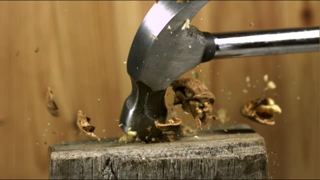 'Hammer breaking Walnut, juglans regia, Slow Motion'