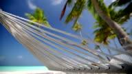 Hammock on a tropical beach, Maldives, Indian Ocean