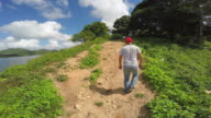 Hanabanilla, Cuba: Point of view of tourist walking the Cuban countryside to get a private boat and tour the natural reserve