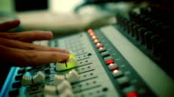 Hand adjusting audio mixer