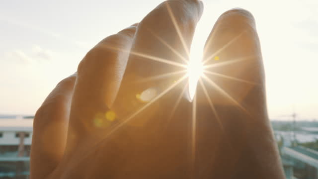hand and sun