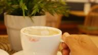 hand drinking coffee