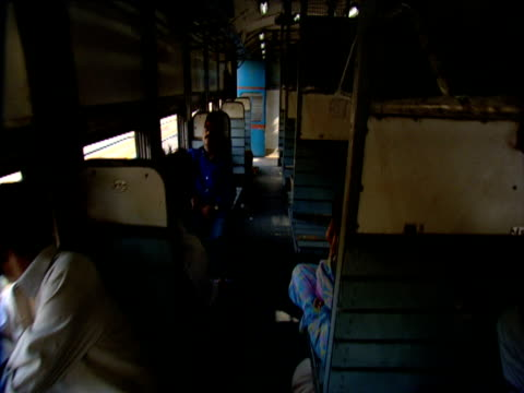 Hand held track through second class train compartments India