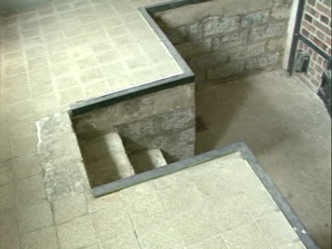 / hand help POV back of gas chamber oven around to front inside the oven with medal stretcher