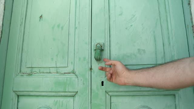 MS Hand hitting at door / San Polo Matese, Molise, Italy