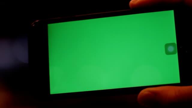 hand hold smartphone green screen