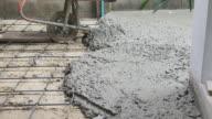 hand of builder worker plastering at floor