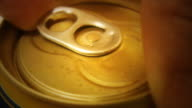 Hand opening can Close-up beer alcoholic drink
