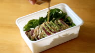 Hand opening healthy lunch box, Tuna Salad.