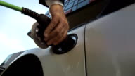 HD SLOW MOTION: Hand Plugging An Electric Car