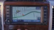 CU Hand programming directions through navigation system / Fillmore, California, USA