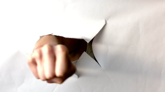 Hand punching durch white paper