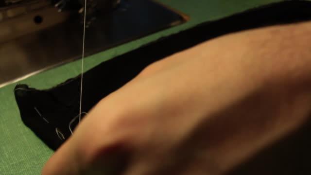 Hand Sewing fabric closeup/dolly shot