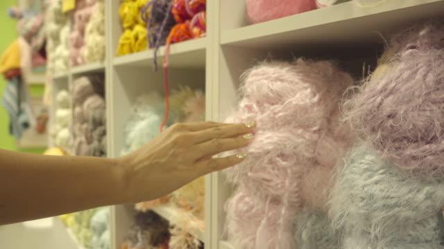 hand touching wool