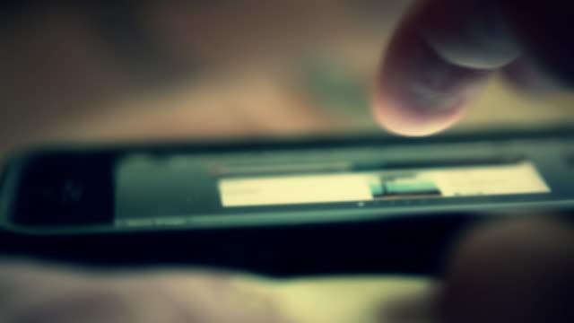 Hand using a smartphone