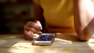 Hand using smartphone.
