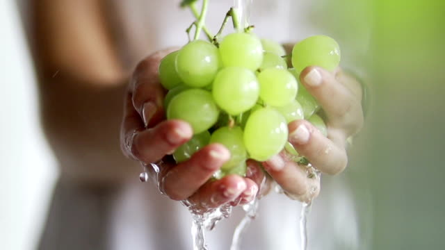 Hand washing grapes in slow motion   FO