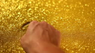 hand writing 2015 on golden sand background