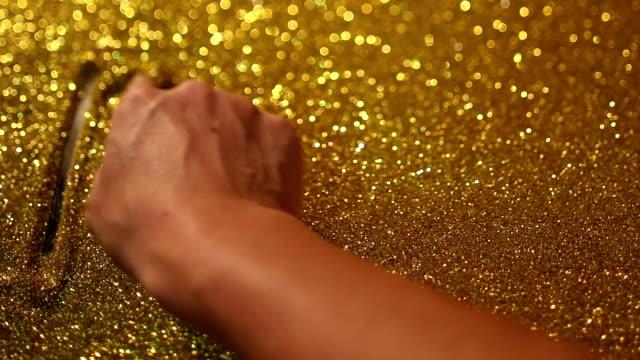 hand writing'dream' on golden sand background