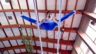 HD: Handheld, Gymnast Performing Routine on Parallel Bars
