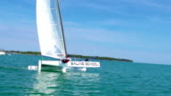 HD Handheld: Handheld Shot of Young Boats-man Leaning on Catamaran