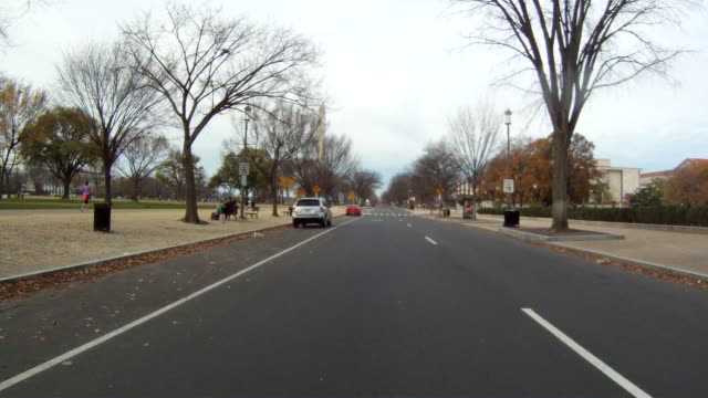 A handheld shot of driving down a curved road in Washington DC.