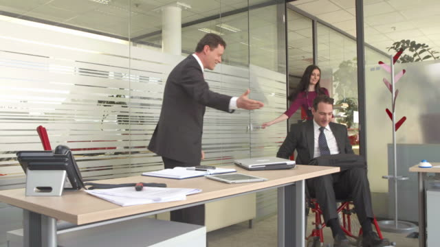 HD DOLLY: Handicapped Businessman Having Meeting