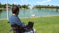 Handicapped Man Using Laptop