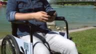 Handicapped Man Using Smart Phone