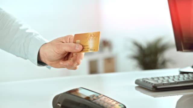 Handing out the credit card to the salesperson
