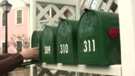 Handing reaching into a mailbox