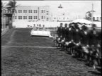 1930 WS Handlers parade greyhound dogs in a line on March 1, 1930 / Miami Beach, Florida