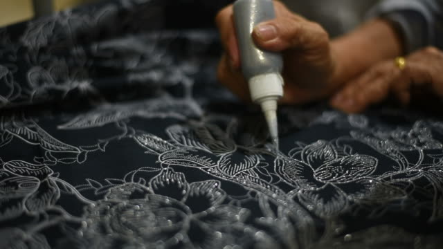 Handmade textile ,painting the patterns for batik.