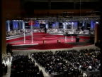 Handover events Convention Centre GV Crowds in hall for handover ceremony as military band play SOT General Sir Charles Guthrie leads British...