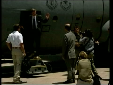 Two days early Events POOL Bremer along on tarmac with Iraqi interim Deputy Prime Minister Barham Salih shaking hands then Bremer boarding plane INT...