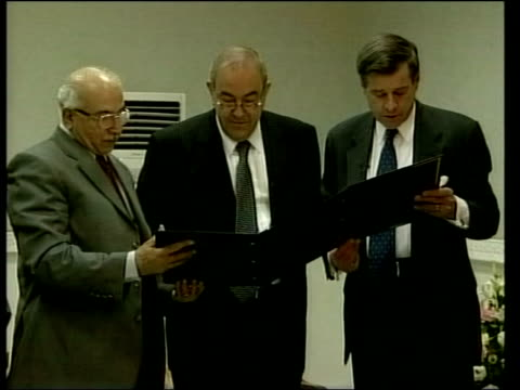 Two days early Events POOL IRAQ Baghdad INT Paul Bremer reading from document as standing next Iraqi interim Prime Minister Iyad Allawi Iraqi Chief...