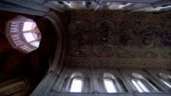 Hand-painted panels decorate the ceiling of the nave in the Ely Cathedral that leads into the Octagon Tower. Available in HD.