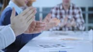 SLO MO Hands applauding in the meeting room