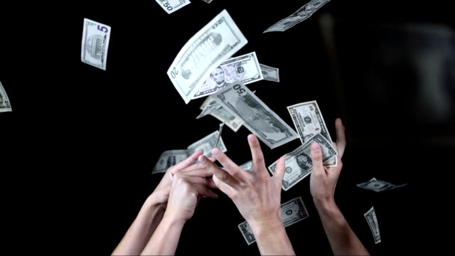 Hands Catching Falling Dollars (Super Slow Motion)