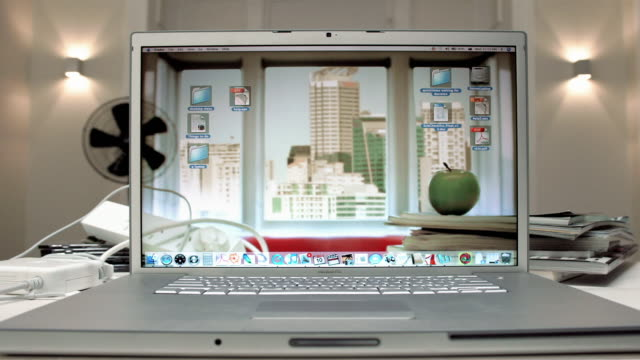 T/L, CU, Hands closing laptop with screen saver depicting environment
