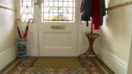 MS Hands dropping letters through letterbox / Chislehurst, Kent, UK