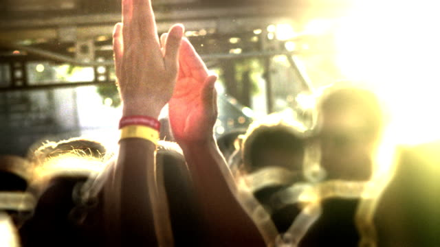 Hands in air in sunset