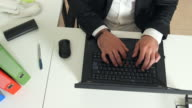Hands of a man office worker typing on a keyboard