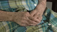 CU Hands of senior woman sitting in nursing home / Trinidad and Tobago